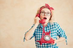 Surprised woman talking by phone stock photos