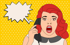 Surprised woman talking on telephone. Stock Image