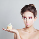 Surprised Woman with Unhealthy Food Royalty Free Stock Images