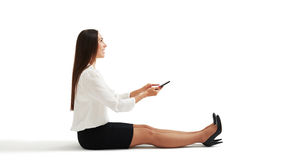 Surprised woman using her smartphone Royalty Free Stock Images