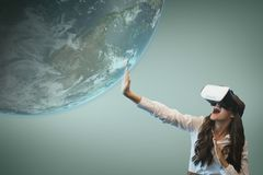 Surprised woman in VR headset touching 3D planet against blue background. Digital composite of Surprised woman in VR headset touching 3D planet against blue stock illustration