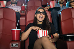 Surprised woman watching 3d movie Stock Photo