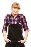 Surprised woman wearing dungarees and check shirt Stock Image