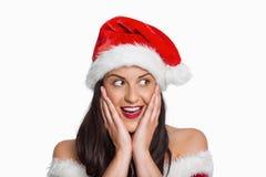 Surprised woman wearing santa hat Royalty Free Stock Image
