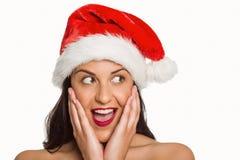 Surprised woman wearing santa hat Stock Photo