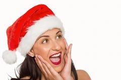 Surprised woman wearing santa hat Stock Photos