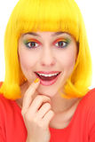 Surprised woman wearing yellow wig. Young woman over white background Royalty Free Stock Images