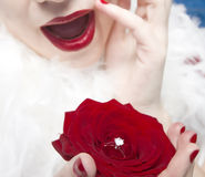 Surprised Woman with wedding ring. Young surprised woman with red lips and a rose with a wedding ring Stock Photography