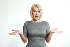 Surprised woman on white. Face expression, emotions, feeling attitude reaction Stock Photos