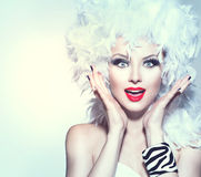 Surprised woman in white feather wig Stock Images