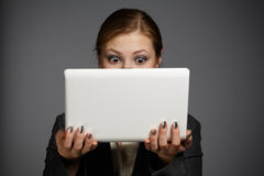 Surprised woman with white netbook Stock Photography