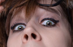 Surprised woman with wide eyes Royalty Free Stock Image