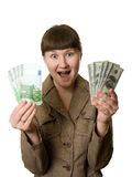 Surprised Woman With Euros And Dollars Royalty Free Stock Images