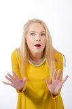 Surprised woman in yellow dress Royalty Free Stock Image