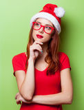 Surprised women in christmas hat Royalty Free Stock Photo