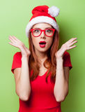 Surprised women in christmas hat Royalty Free Stock Images