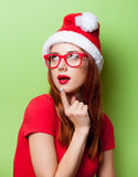 Surprised women in christmas hat Royalty Free Stock Photos