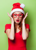 Surprised women in christmas hat Stock Photography