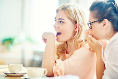 Surprised Women at Coffeehouse Royalty Free Stock Photos