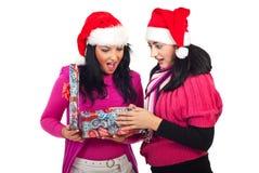 Surprised women open Christmas gift box stock photos