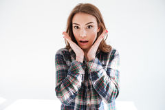 Surprised wondered young woman in plaid shirt with opened mouth Royalty Free Stock Photography