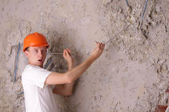 Surprised worker electric trying and cable Royalty Free Stock Photography
