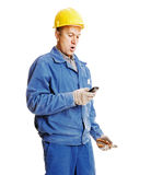 Surprised workman reading message Royalty Free Stock Images
