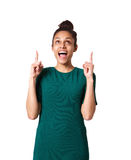 Surprised young african woman pointing up Stock Image