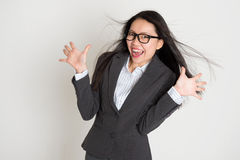 Surprised young Asian business woman Stock Photo