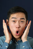 Surprised young Asian man Royalty Free Stock Images