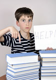 Surprised young boy and books Royalty Free Stock Photos