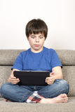Surprised young boy and a tablet digital Royalty Free Stock Photos