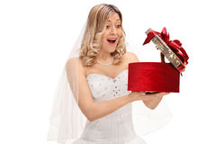 Surprised young bride opening a present Royalty Free Stock Images
