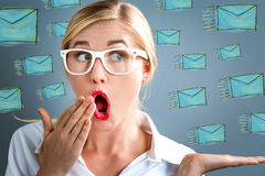 Surprised young business woman with emails. Surprised young business woman with many emails royalty free stock photos