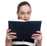 Surprised young business woman looking at diary Stock Photos