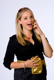Surprised young businesswoman talks on cell phone. Royalty Free Stock Images