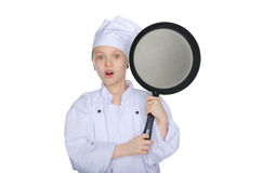 Surprised young chef with a pan Stock Photography