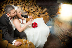 Surprised young couple sitting in front stock images
