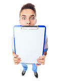 Surprised young doctor showing empty clipboard Stock Photos