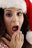 Surprised young female with christmas hat Stock Images
