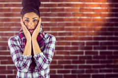 A surprised young female hipster Royalty Free Stock Photos