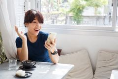 Surprised young female received sms message with discount from o stock photos