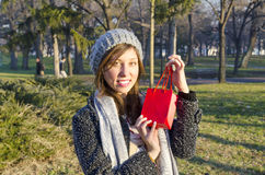 Surprised young girl posing with a red gift box Stock Images