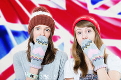 Surprised young girls in hats and mittens Royalty Free Stock Photos