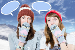 Surprised young girls in hats and mittens Royalty Free Stock Photography