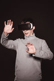 Surprised young in the gray sweater, the man in the glasses of virtual reality. Stock Image
