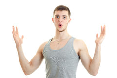 Surprised young guy in Jersey raised his hands to the sides Royalty Free Stock Images