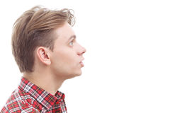 Surprised young guy standing half-face Stock Photography