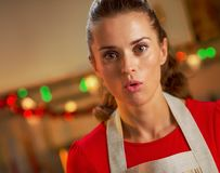 Surprised young housewife in christmas decorated kitchen Royalty Free Stock Photography
