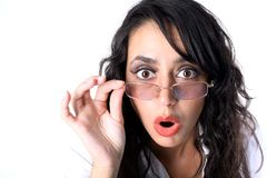 Surprised young lady in glasses Stock Images
